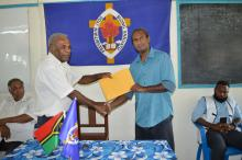 Pastor Allen Nafuki handed over the donation to the Director of NDMO Abraham Nasak.