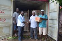 Mr Stanley Alick handed over the container of baked beans to Director Mike Waiwai from NDMO.