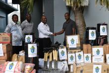 Bishop James Tama presented the relief supplies to NDMO Director Abraham Nasak with ACOM representatives at the NDMO office in Port Vila.