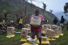 A member of Sanma village in South Pentecost receiving relief food supplies from NDMO.