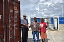 Mr Gorden handed over the two containers of clothing to Director Sammy and Mrs Tarileo in Santo.