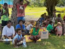 Families affected by the Tanna Ash Fall receiving relief food supplies from NDMO.